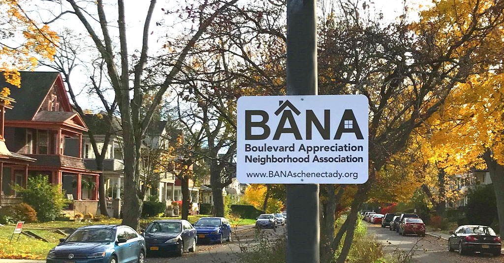 Fall photo showing BANA sign in front of a street